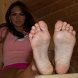 Brunette Moni shows feet in a sauna